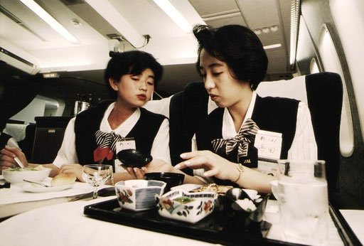 Japan Air Lines cabin crew trainees ponder how to explain a Japanese-style inflight meal in English; Tokyo, Japan.