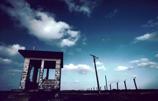 The remains of a guardpost and fencing of the secure area inside the former Air Force facility on Iwo Jima. Nuclear warheads were stored here in the 1960s in preparation for a possible nuclear 'second strike' against the Soviet Union.