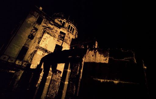 A false-color infrared image of the Hiroshima Dome.  The color and contrast are intended to evoke the searing heat and blinding light of a nuclear detonation.