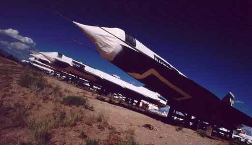 Once super-secret Mach 3+ D-21 reconnaissance drones, built to be launched from SR-71s, are sealed in 'mothball' storage at AMARC. The D-21s were to spy on China's Lop Nor nuclear test site. Four missions were attempted; none succeeded.
