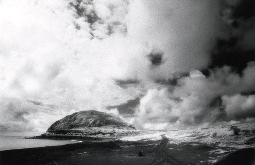 The infamous island battleground of Iwo Jima, looking southward to Mt. Suribachi across the landing beaches.