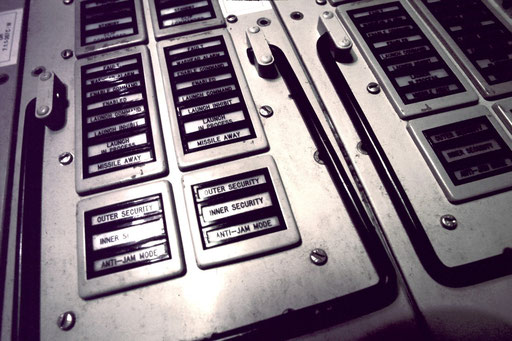 The stages of a Minuteman II launch are visible on the console.  Each column of indicators displays the series of those stages in the launch sequence of a single ICBM. Perhaps the most chilling is 'Missile Away.'