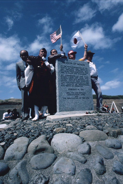 Veterans from both sides, the son of Baron Nishi Takeichi (at left, wearing a suit), and a Buddhist priest at a memorial dedication, 1985: Iwo Jima, Japan. Baron Nishi won an equestrian gold medal at the 1932 Olympics; he died in the battle here in 1945.