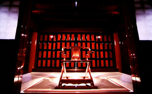 Part of the Usasuka 'throne room' on the upper level of Shuri Castle. If the red-and-black sliding panel doors are opened and the royal chair turned around, the seated king can look directly down on the wide courtyard below.  Shuri Castle, Okinawa, Japan.