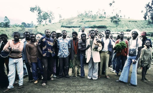 Countryside Congolese examine the 'wazungu'  -- foreigners -- who have stopped by their marketplace; Kivu, DRC.
