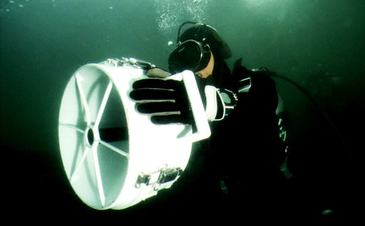 Divers of the Japan Maritime Self-Defense Force deploy a handheld sonar unit; in the waters off Kanagawa, Japan.