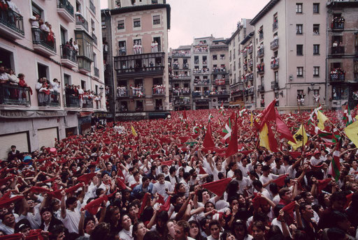 A crowd fills the streets on the opening day of the Sanfermines, the 'running of the bulls', Pamplona, Spain.