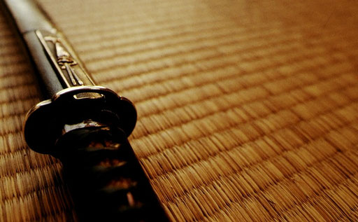 A wakizashi -- a Japanese short sword -- at rest on tatami.