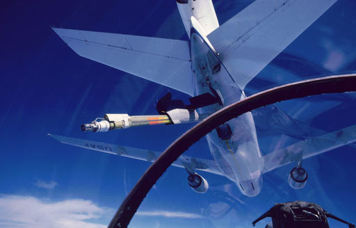 Approaching a KC-10 tanker to refuel, as seen from an F-15 cockpit.  The refueling boom receptacle is just aft of the port wing root leading edge, hence the F-15 is slightly offset to the right of the KC-10's centerline.