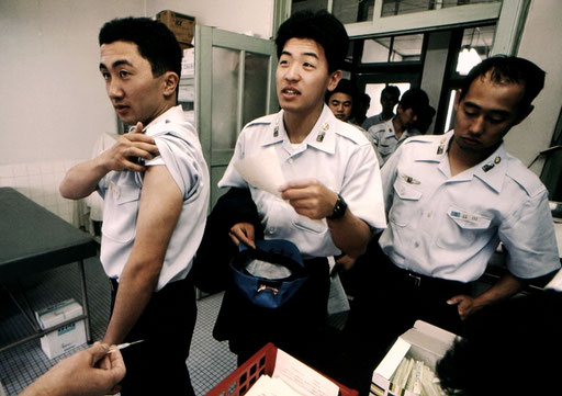 Japan Air Self-Defense Force officer candidates getting the first shot of a battery of immunizations; Nara, Japan.
