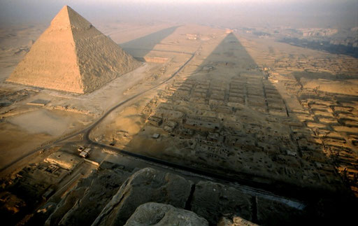 The sunrise throws long shadows from the Pyramids of Giza. This view is from the top of the Pyramid of Khufu (the Great Pyramid);  The Pyramid of Khafre is at left.