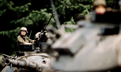 A Japan Ground Self-Defense Force tank platoon commander, on maneuvers with his unit near Shikaoi, Hokkaido, Japan.
