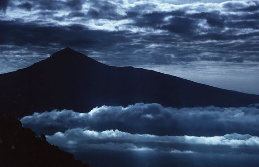 Looking across the DRC-Rwanda border from one equatorial volcano to another; Mt Karisimbi seen from Mt Nyiragongo.