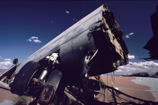In compliance with the START I provisions, the fuselage of a B-52G lies in the desert landscape of the Aerospace Maintenance and Regeneration Center (AMARC) at Davis-Monthan AFB, Arizona. It was severed by a huge, specially-built 'guillotine.'