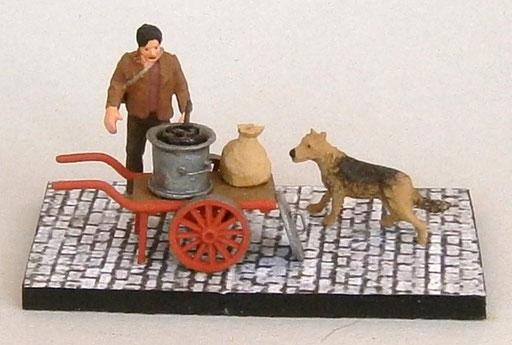 Vendeur de marrons chauds avec son chien