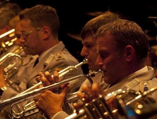 Trompeten für Tod und Verderben. Militärmusiker bei der Arbeit.