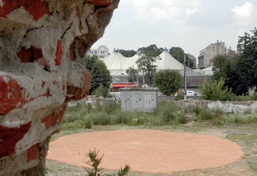 operation mars - red dot or the neverlanding story. in the frame of 'speculations on space'. ground made of the powder of bricks as a meeting point and landmark. the powder was carried out in the profile of the shoes into the town