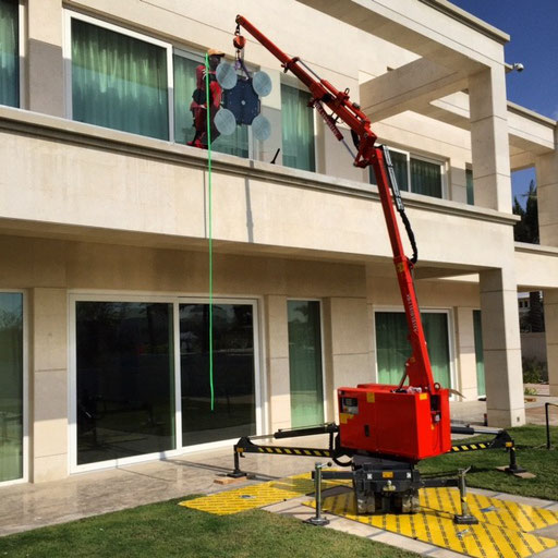 Our Crane in Action installing Balustrade Glass Panels in Emirates Hills, Dubai.