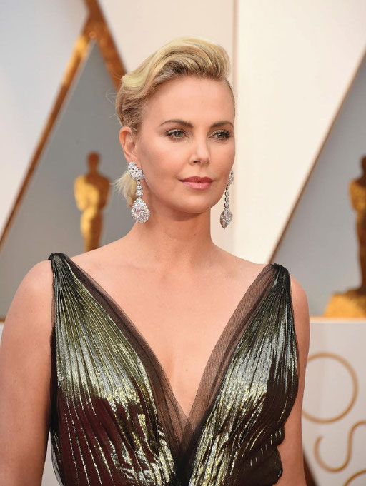 Charlize Theron in Chopard earrings, featuring a 25-carat pear-shaped D-flawless diamond and 26-carat heart-shaped D-flawless diamond, 4.55-carats of pear-shaped diamonds and 4.35-carats of brilliant-cut diamonds set in 18k white '