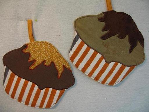 Topflappen in der Form von Muffins