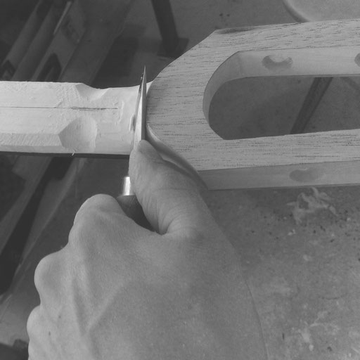shaping a slotted head Ulrich bassguitar by hand - read the review in bassmagazines