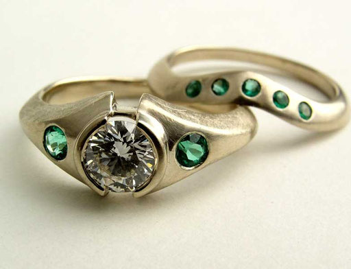 Diamond, emerald ring and matching band, platinum