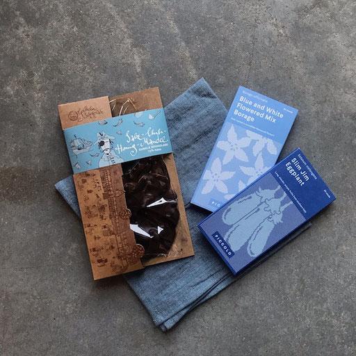 Schokolade Goldhelm 7,50€/100g | Samentütchen piccoloseeds verschieden Sorten 3,30€ | Serviette Leinen proflax 9,90€