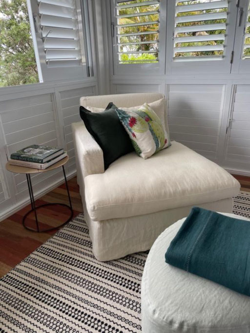 Cushions on an O&L Chaise Lounge in white linen sausage in a bedroom