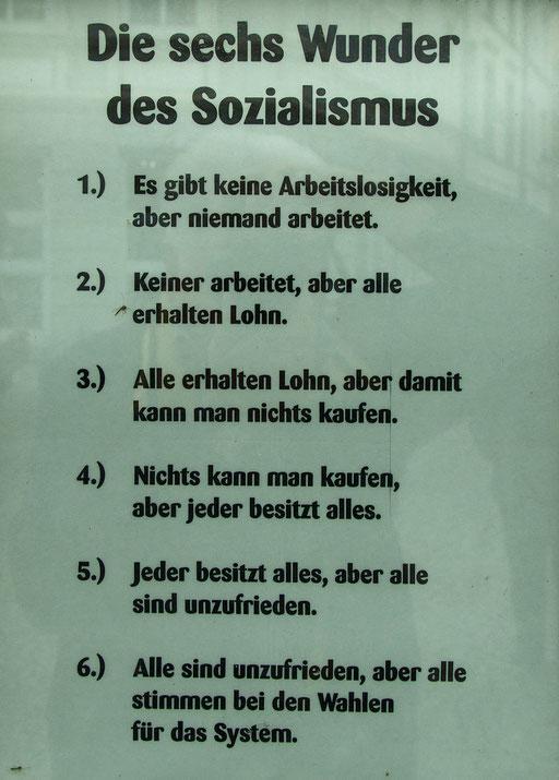 Die 6 Wunder des Sozialimus...   /Gesehen in den Fenstern einer Eckkneipe