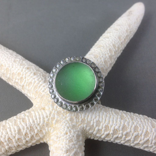 """A statement ring made up of a well-frosted """"shipwreck"""" marble, from the days when marbles were used as ballast in ship hulls. If the ship sank, it could take decades for the marbles to roll ashore. Finding them is such a thrill."""