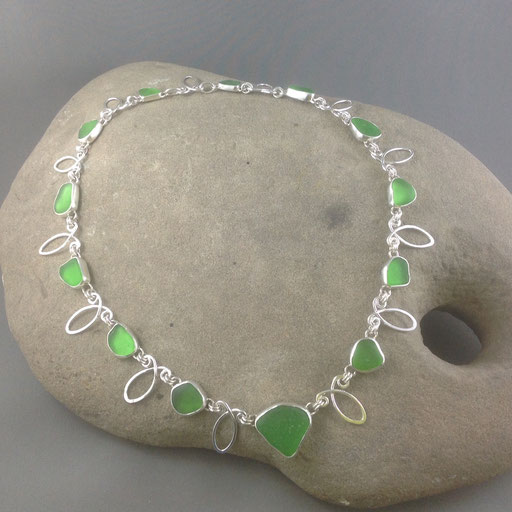 """This emerald sea glass neckpiece was inspired by Elizabethan era jewellery (thanks to the classic movie channel and a rainy afternoon). """"Loopty Loop"""" was awarded an Honourable Mention in the Ladysmith Fine Arts Show a few years ago."""