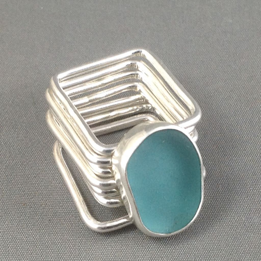Seven square bands attached to one gorgeous chunk of authentic turquoise sea glass. The ultimate fidget ring!