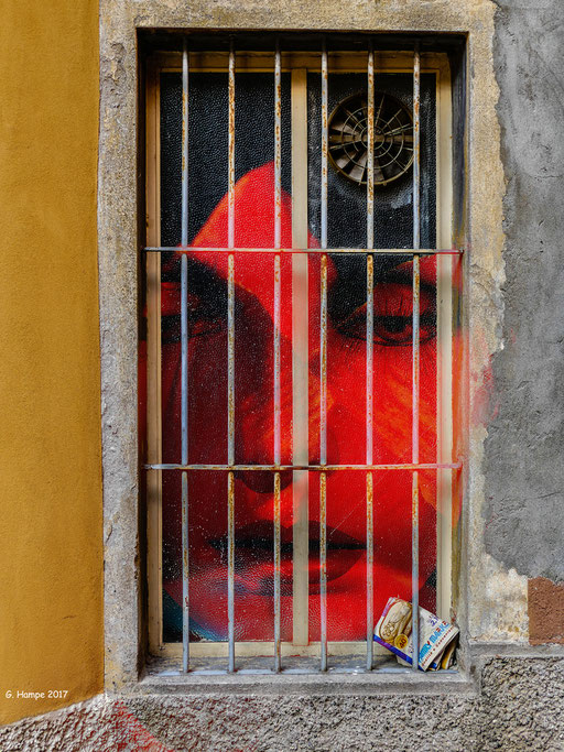 The red face behind the old window