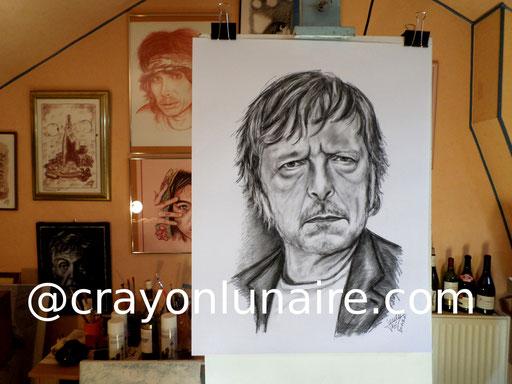 Portrait Renaud portrait au fusain.