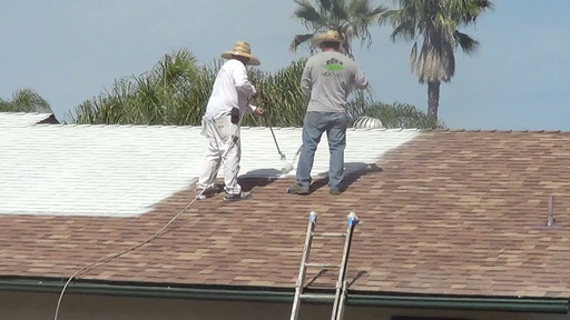 Application of the first coat of Ceramic InsulCoat Roof tinted to a light gray on a Residential Asphalt Shake Roof