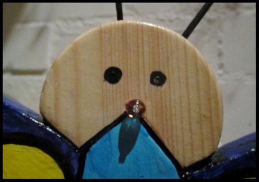 Detail Nestkastje in vorm van Vlinder, kop