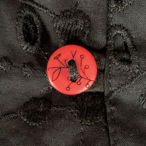 Red Buttons on Black Magic Embroidered Cotton