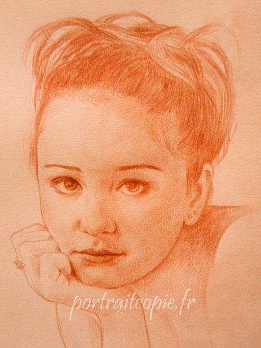 portrait dessiné sur commande, réalisé  au crayon sanguine à  partir d une photo.