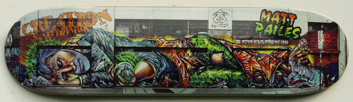 Photograph of the Godimen Mural on Skateboard. Limited edition Skateboards.  Sold Out.