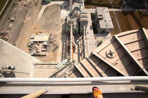 Natalya Starodubets, UCEE economist, leans a feet over Turning Stove/Heat-exchange tower of new dry-method cement production line in 'Sukholozhsk Cement Plant'. The big tubes lying over 100 m. down, bring sand from Clinker Storage Reservoir to the tower.