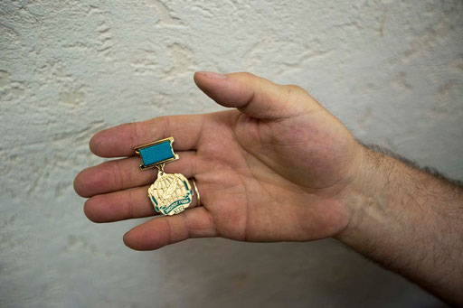 Dr. Valery Anufriev, shows a medal of honor, received in 2012 for works of the company in developing strategies for green low-carbon economy in Sverdlovsk area by Independent Public Council of the Russian Federation and Globe International Academy.