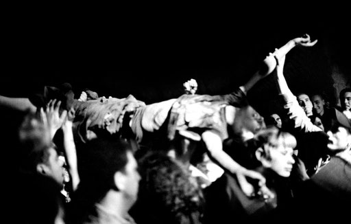 Stage-diving fan during a hardcore concert in squatted center 'Forte Prenestino'. 2006.