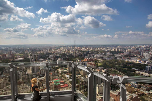 From the top of 'Vysotskiy Tower', Anna looks at her city, Yekaterinburg.