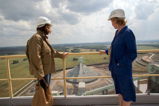 At 100 m., Natalya Starodubets (on the left), economist of UCEE, with the head of the environmental department of the 'Sukholozhsk Cement Plant', look the big Clinker Storage Reservoir, from Turning Stove/Heat-exchange tower of new cement production unit.