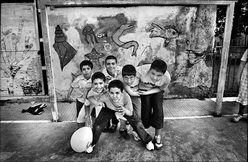 Arab children pose before during a soccer match in the courtyard of Italian public school of the neighborhood called 'Scuola San Felice', where they attend the regular Italian classes as well as Arabic courses.