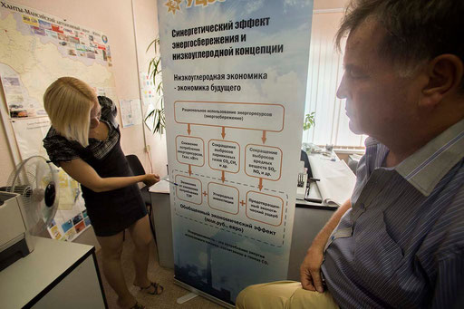 UCEE Director, Dr. Valery Anufriev, and Director Assistant, Anna Panchenko, talking about the banner they will expose at the Russia's main trade fair INNOPROM-2013, which takes place in Yekaterinburg city during the second week of July.
