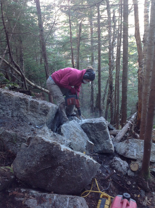 Hilary drills a boulder into step sized rocks for a staircase
