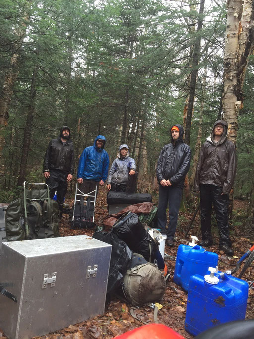 The crew packs out gear on our final soggy and cold day