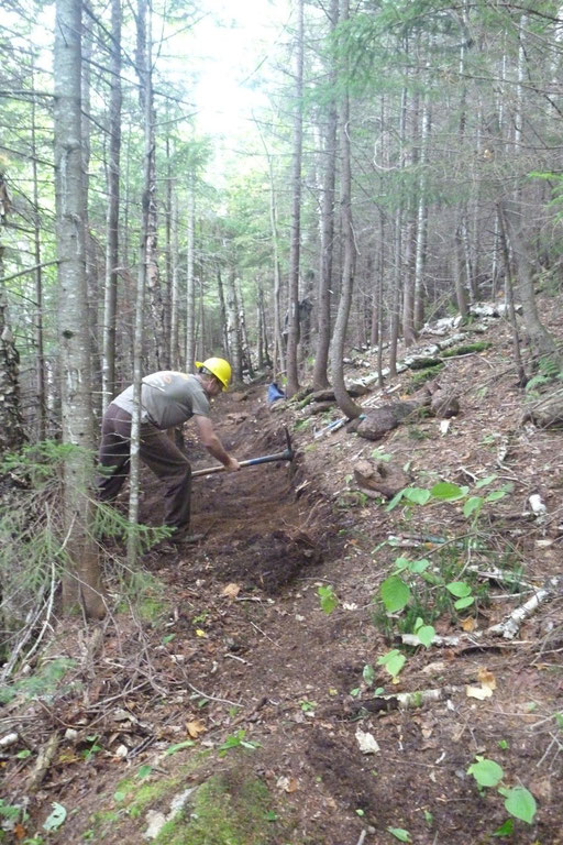 On top of the ridge, there was mineral soil so we could cut a bench in the more traditional manner