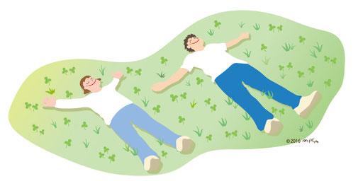 野原で寝ころぶ二人